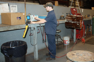 Brandon tests a stator rewind using our baker 6E surge tester before assembly.
